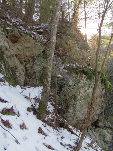 rock cliff to left of falls